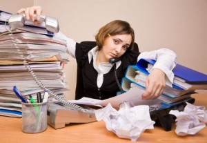 Young women at work overwhelmed