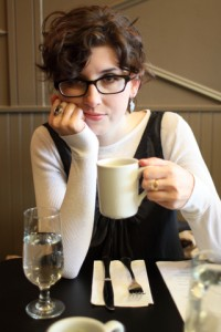 Tired woman drinking coffee