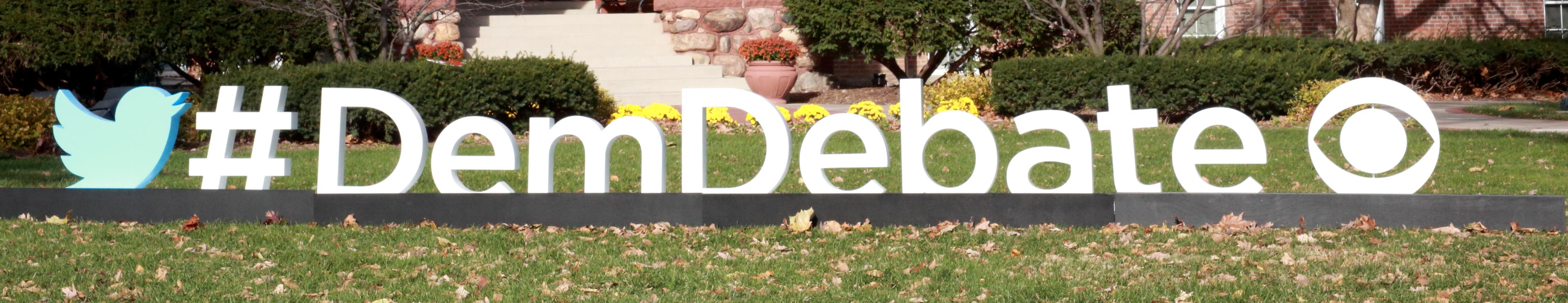 #DemDebate sign